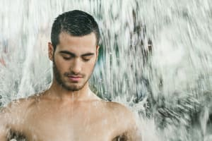 Man in aromatherapy shower in spa