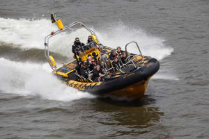 A group riding a thames rib speedboat