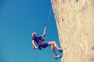 Abseiling climbing