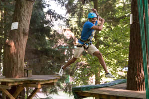 A man on a high ropes course