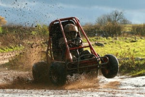 A Gemini Liberator off road kart on a muddy off road course