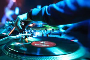 A dj plays in a nightclub party