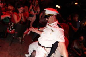 A male stripper does a dance on a hen party