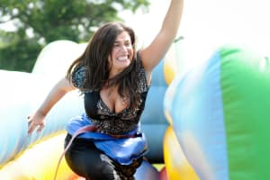 A woman participating in it's a knockout activity
