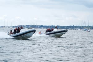 power boats going through the sea
