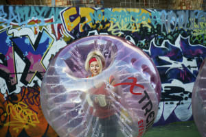 a happy hen party playing zorb football