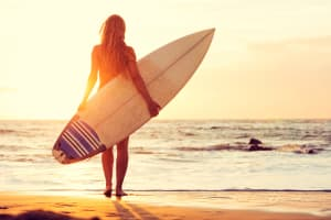 A female surfer on a beach