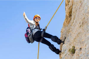 A woman abseiling
