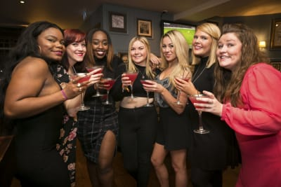 A group of women enjoying a hen party cocktail making