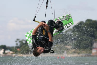 man doing a kite surfing trick