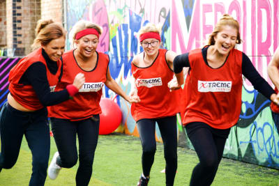 A group of girls having fun at a school sports day