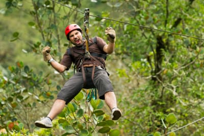 A man having fun on a high ropes course
