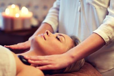 A woman receiving a relaxing head massage