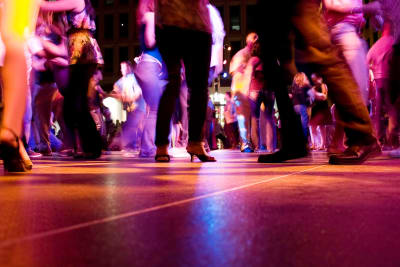 A group of people taking a salsa dancing lesson
