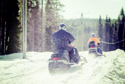 Two men on snowmobiles