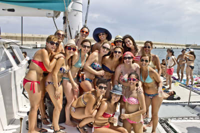 An attractive hen group celebrating on a party boat