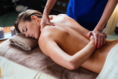 A woman enjoying a thai massage