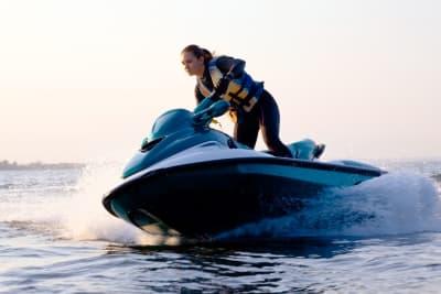 a woman jetskiing