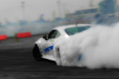 A car speeding around a racetrack