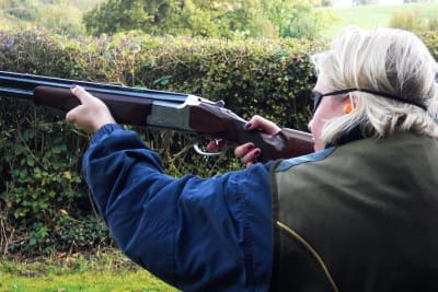 A woman clay pigeon shooting