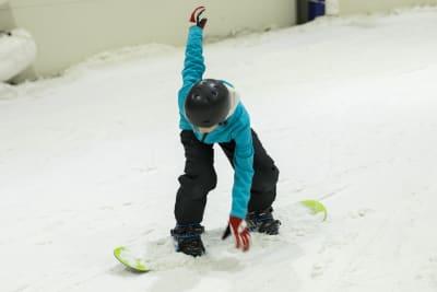 man snowboarding inside ski resort
