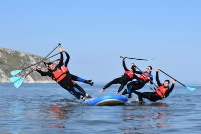 Falling off a paddleboard into the sea