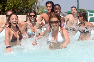 Mountain Spa Retreat group of friends having fun in outdoor pool in sunshine