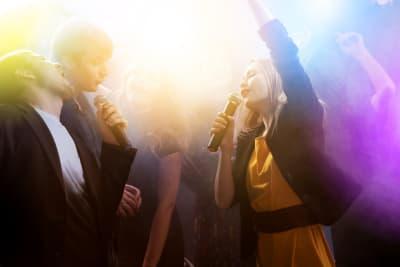 Lip Sync Battle karaoke friends dancing in busy venue