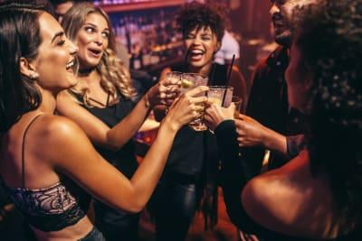 friends drinking in nightclub together VIP
