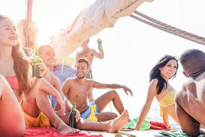 group of friends on boat enjoying sunshine
