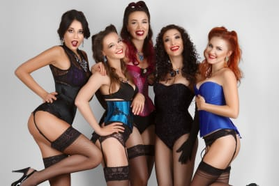 Five women dressed in burlesque outfits dance class
