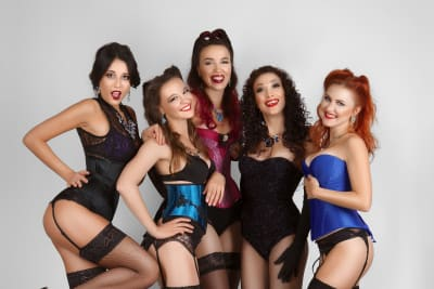 five women dressed in burlesque dance lessons