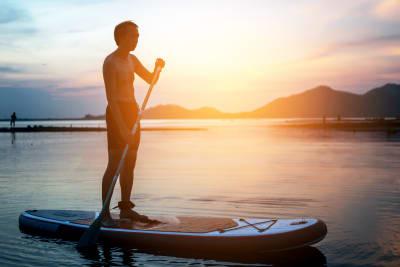 man paddle boarding in lake