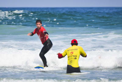 A man taking a surfing lesson