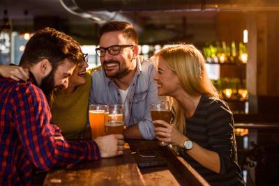 Friends drinking in bar having fun