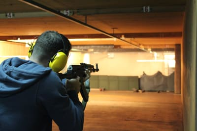 A Stag shooting a gun whilst target shooting