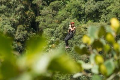 A woman going down a zip line