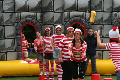 Hen group playing It's a knockout