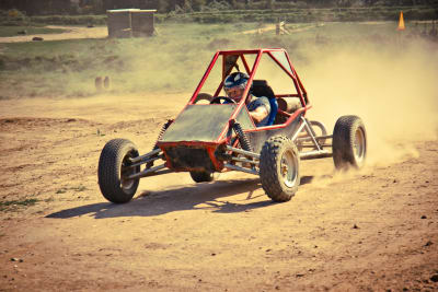 rage buggy dirty buggy off road kart on dusty track