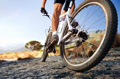 Man riding along a path on a mountain bike
