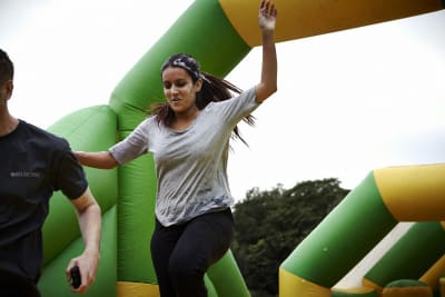 Inflatable assault course woman and man