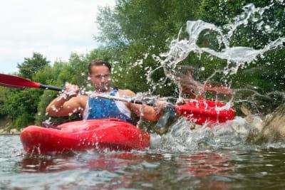 a man paddles in a kayak