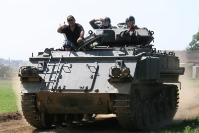 A stag group driving a tank