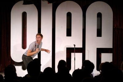 Glee Club Cardiff - Russell Howard performing on stage
