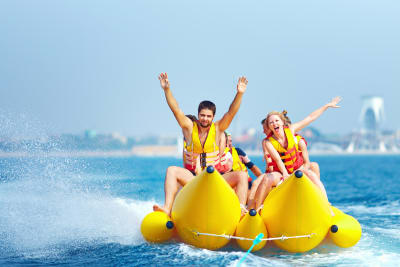 group on a banana boat in the ocean
