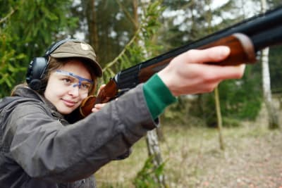 A woman shoots clay pigeons