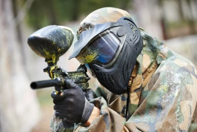 A group of people having fun playing paintball