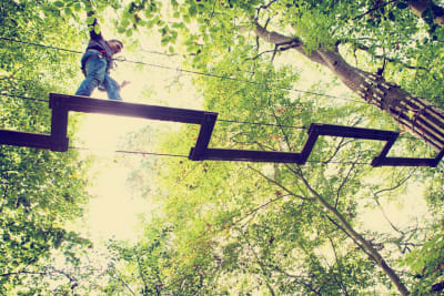 a man on high ropes