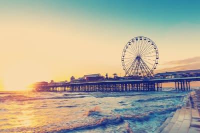 Blackpool pleasure beach and pier at sunset