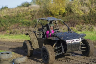 A woman having fun in an off road buggy